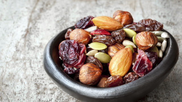 Trail mix in black bowl.  Delicious healthy fruit, nuts and seed