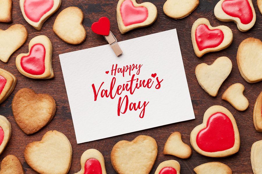 Valentine's day greeting card with heart shaped cookies on woode