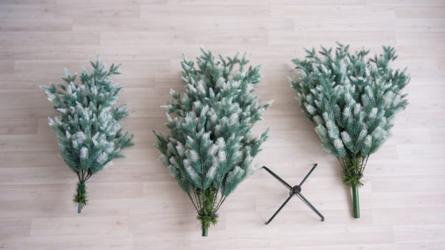 Close-up Of Pieces Of Artificial Christmas Tree. The Process Of