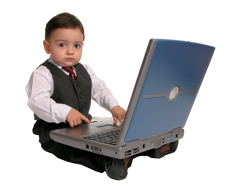 Boy Child In Business Suit On Laptop Looking At Camera