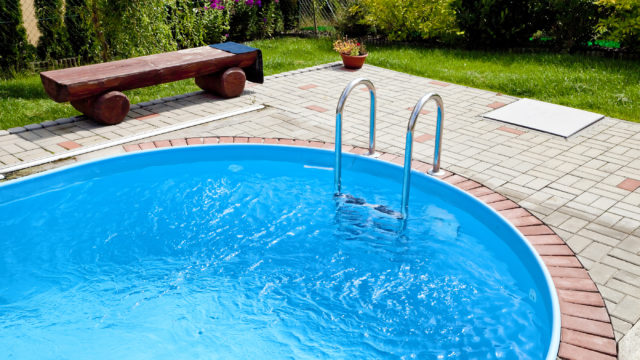 Pool With Blue Water And Metal Swimming Pool Steps