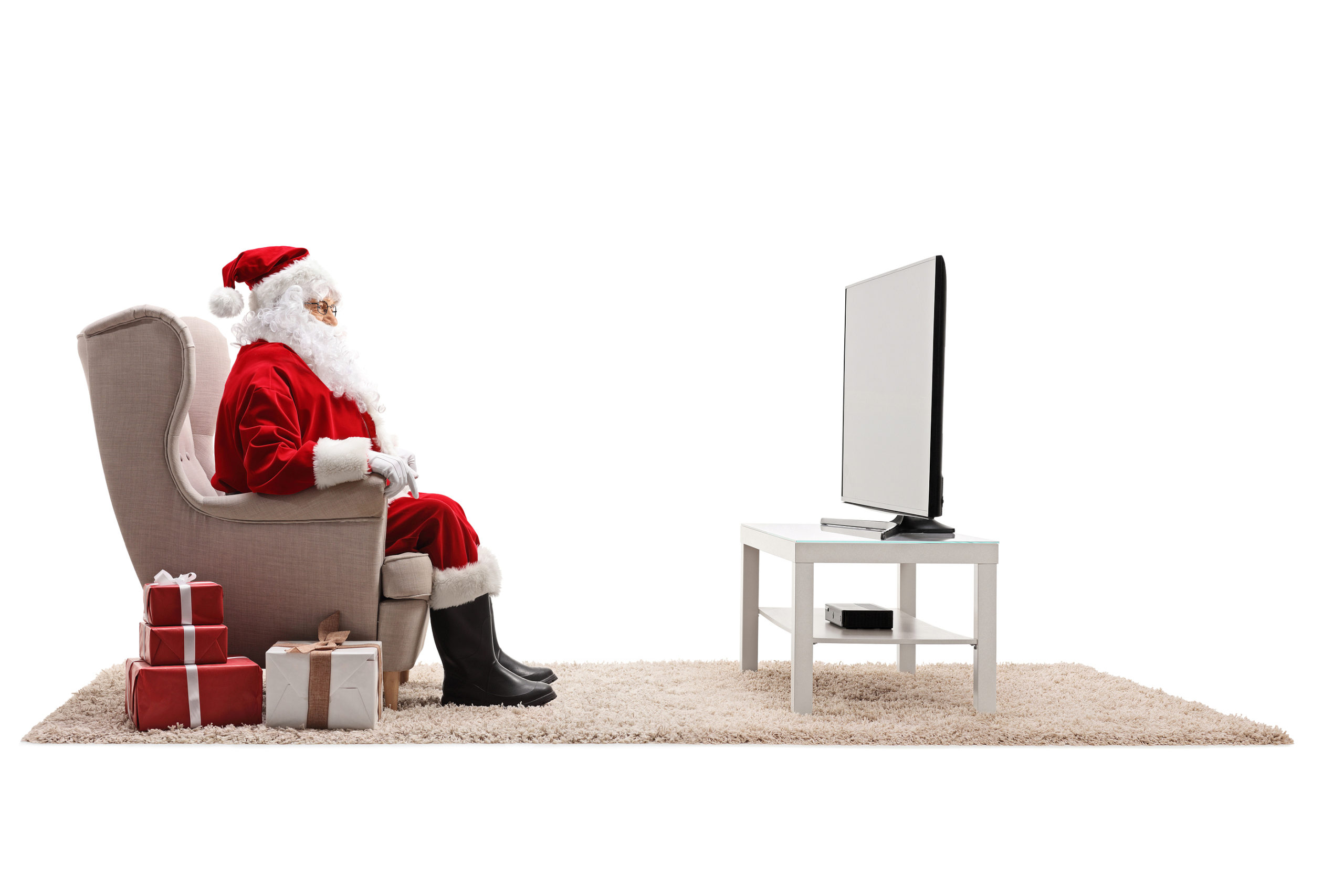 Santa claus watching tv with presents on the floor isolated on w