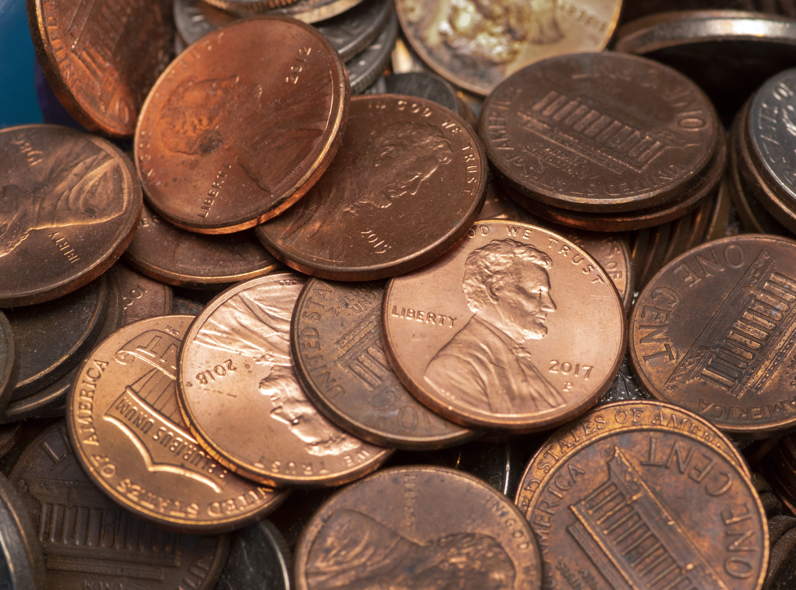 Many Shiny And Dull Copper Us Pennies Piled Together